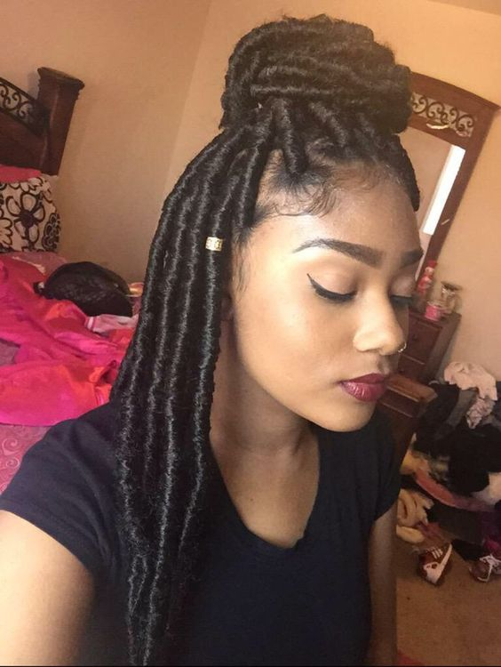Marley Locs with Small Bun Top of Head