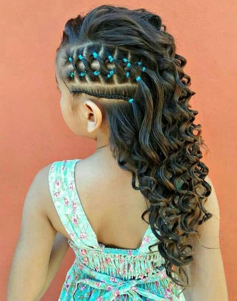 3. Big Curls with one sided cornrows